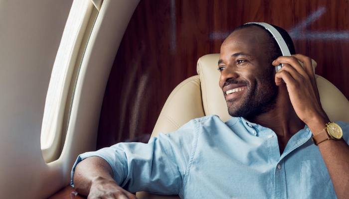 Man in headphones with jet card