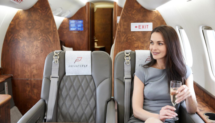 Woman seated jet account